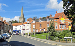 Photo of Smiddy Hill Pickering with the church in the background