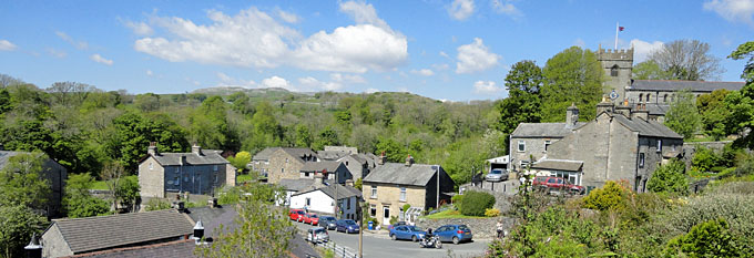 Photo of Ingleton Village - View of limestone scenery in distance.