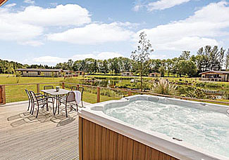 Outdoor hot tub at Daleside Lodge ( Ref LP7305 ) Holiday Lodge at Cedar Retreats near West Tanfield North Yorkshire
