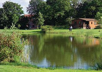 Park setting at Paradise Lakeside Lodges near York