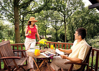 Enjoy a drink on the verandah of Lilleskov Lodge ( Ref LP1824 ) at Spring Wood Holiday Lodges Nidderdale North Yorkshire
