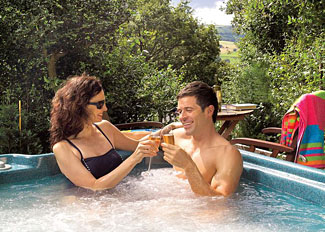 Relax in the outdoor hot tub at Lilleskov Lodge ( Ref 1824 ) Spring Wood Lodges in Nidderdale North Yorks