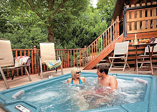 Outdoor hot tub at Skovarel Lodge ( Ref LP2274 ) Holiday Lodge at Spring Wood near Harrogate Nidderdale North Yorkshire