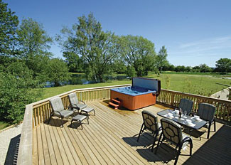 View from verandah with outdoor hot tub at Newton Dale Lodge ( Ref LP7200 ) Pickering Holiday Lodges North Yorkshire