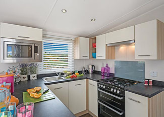 Kitchen at typical Bella Caravan ( Ref LP15271 )at Cayton Bay Holiday Park Scarborough North Yorkshire