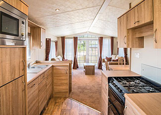Typical Deluxe Spa 2 Holiday Home living area ( Ref LP8982 ) at Applegrove Holiday Park near Scarborough
