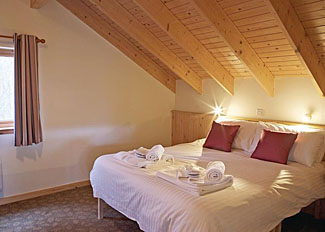 Photo of typical Golden Oak Lodge bedroom ( Ref LP4136 ) at Keldy Forest Lodges near Cropton North Yorkshire