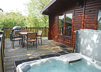 Outdoor hot tub at Lindale Pine Lodge ( Ref LP3000 ) at Lindale Park - Holiday Lodge near Bedale North Yorks