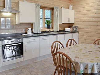Well-equipped kitchen & dining area in Chloe's Lodge ( Ref UK2210 ) Holiday lodge at Sycamore Farm Cropton